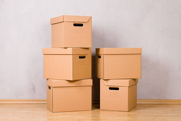 stack of cardboard boxes. you can add your own gift/goods to the inside of the boxes or in front of...